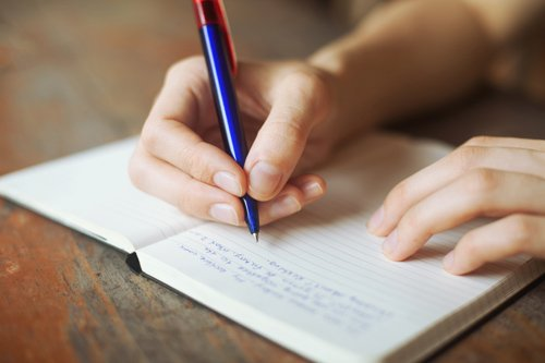 hand - writing in notebook