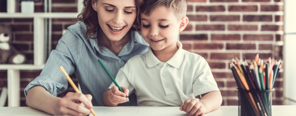 Boy and Mom doing schoolwork Exceptional Needs and the Future