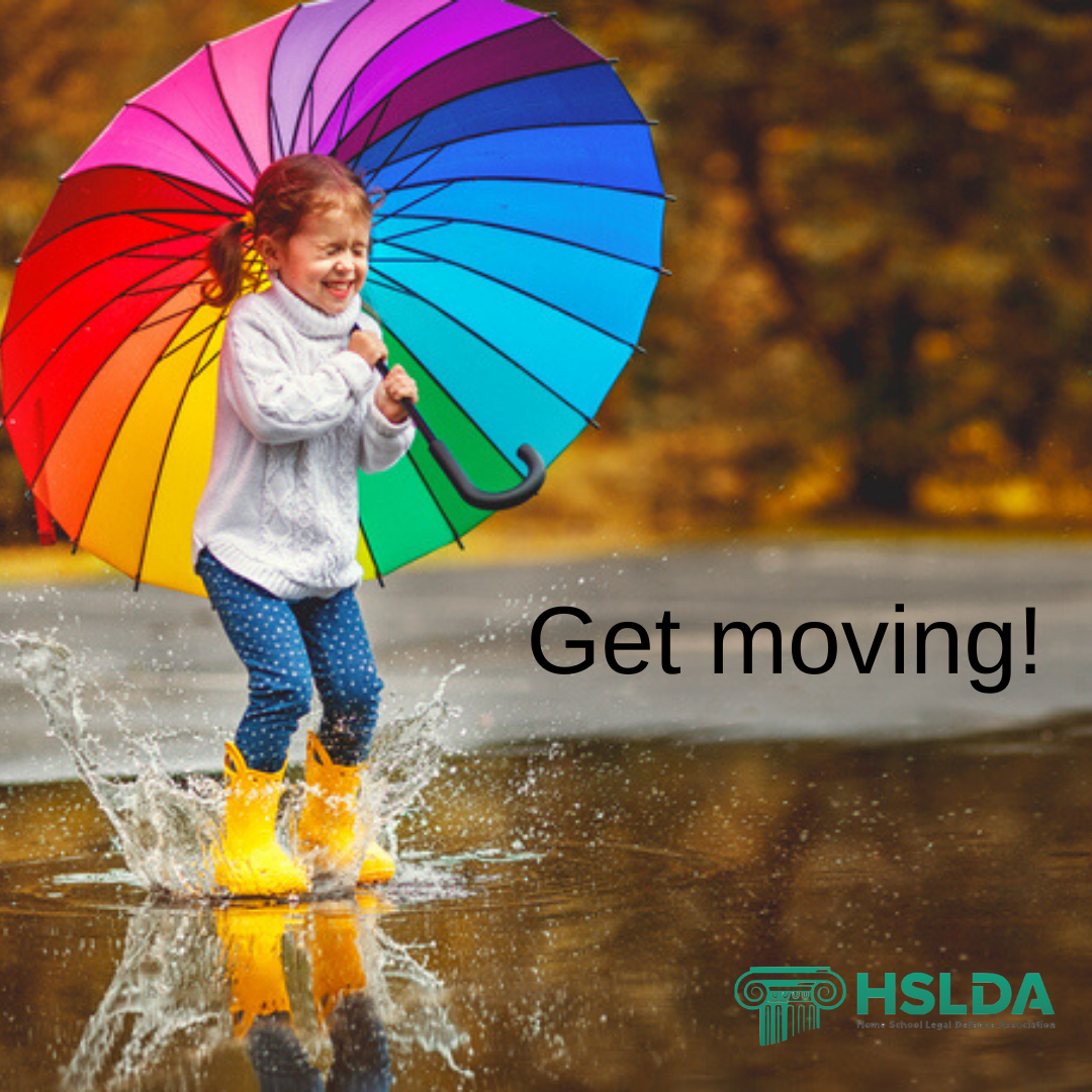 Get moving - get outside girl with umbrella in puddle